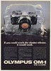 1982 Olympus OM-1 Camera in Block of Ice Shutter Release Would Work Print Ad